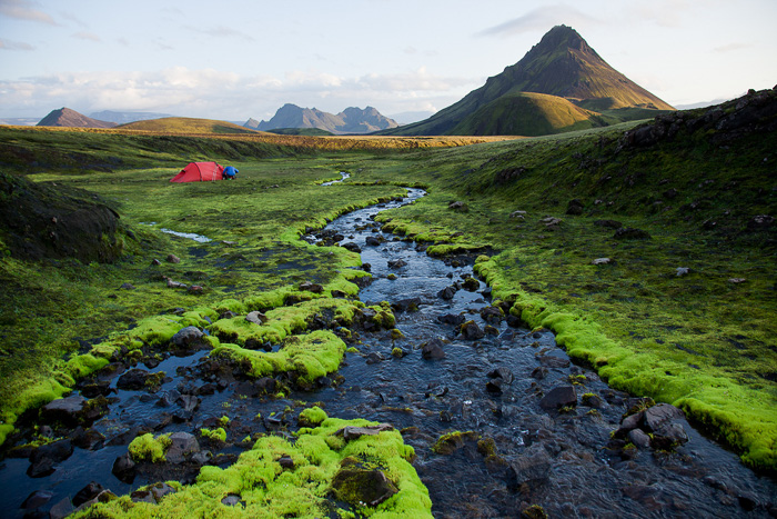 Red tent, green landscape in Iceland