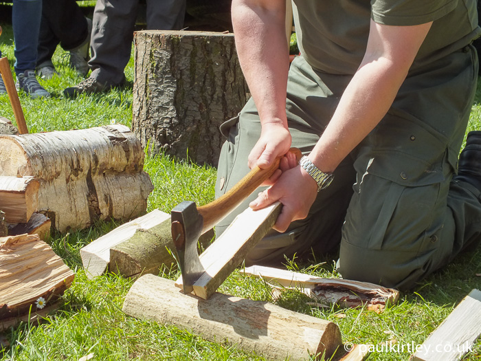 The author demonstrating splitting techniques during an axe technique demonstration from chopping block, log section to a piece of the split wood itself.  Work with what you've got, safely using an appropriate technique.""