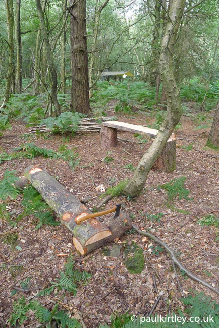 A break while building new benches for a semi-permanent camp in Sussex, England, the axe is embedded in one of the low bench supports. Photo: Paul Kirtley