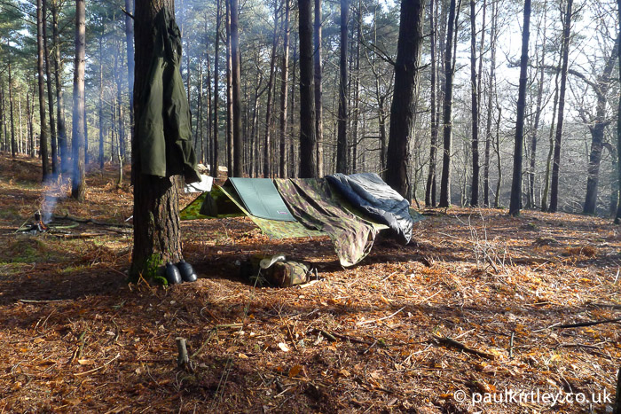 Tarp in sunshine with bivvy bag and sleeping bag draped over the top to air out
