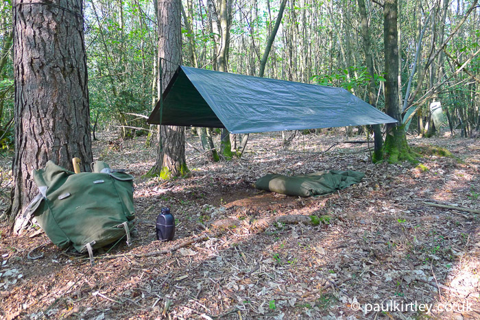 tarp and rucksack in the woods