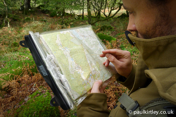 Pointing out map features with a blade of grass