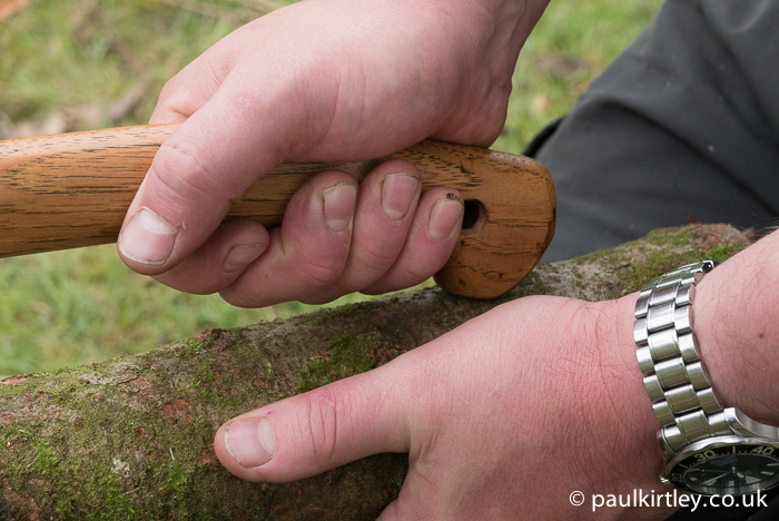 Axe handle hand position for small wood splitting technique