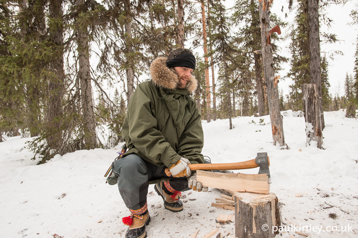Splitting wood into small bits winter camping.
