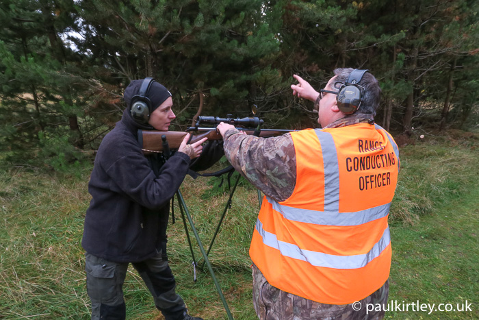 Man teaching lady how to use a .243 calibre deer rifle