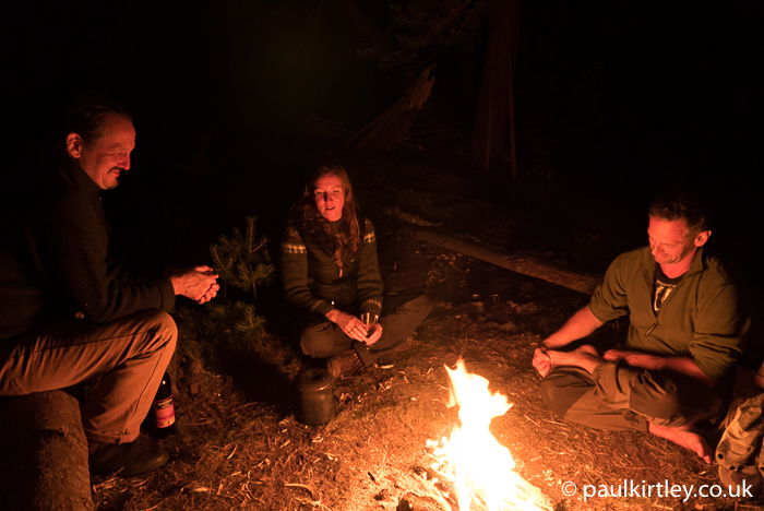 Juha Rankinen, Lisa Fenton and Iain Gair around a campfire