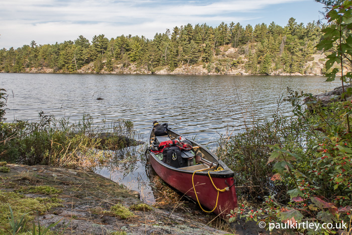 Canoe with gear in Canadian Shield country