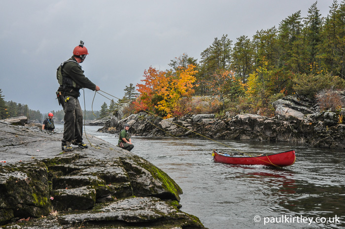 Man tracking canoe upstream