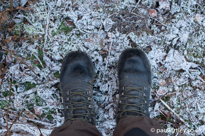 Boots on frosty ground.