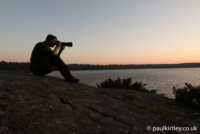 Paul Kirtley using DSLR camera at dusk
