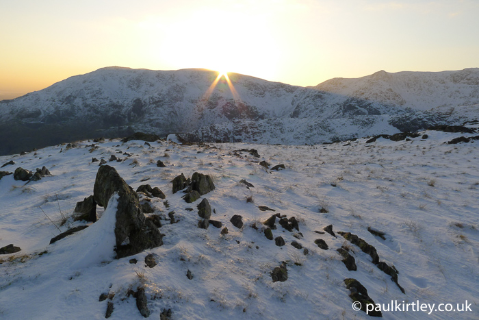 View of sunset in Lakeland fells in winter