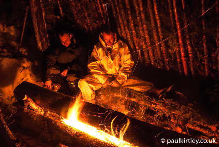 men and long log fire
