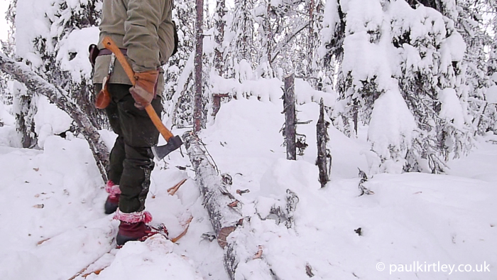 Working with axe on snowshoes.