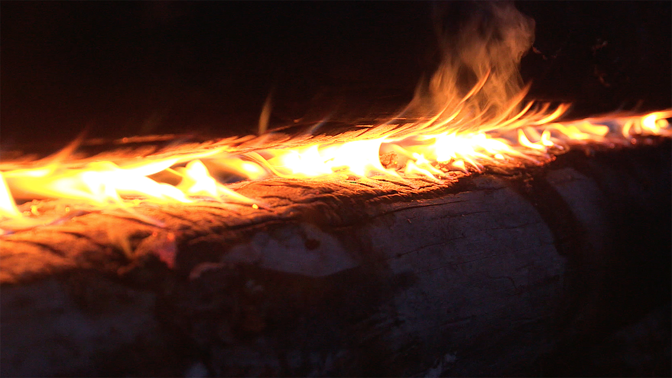 Swedish long log fire known as Nuorssjo closeup of steady flame