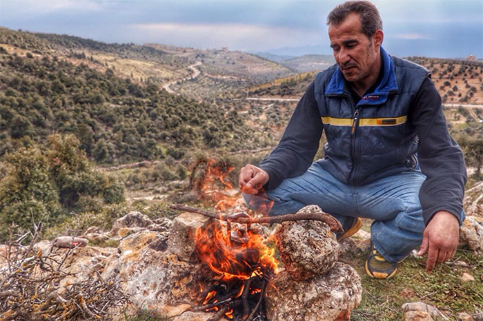 Man making fire in Jordan