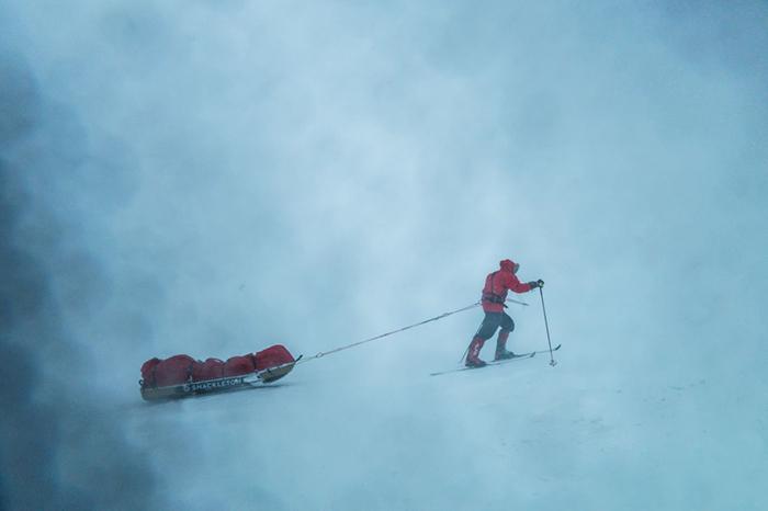 Man pulling pulk in polar conditions