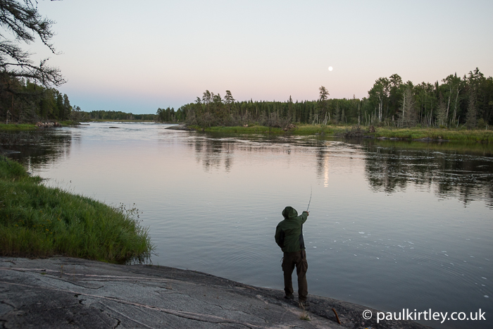 Man fishing on the river in Canada