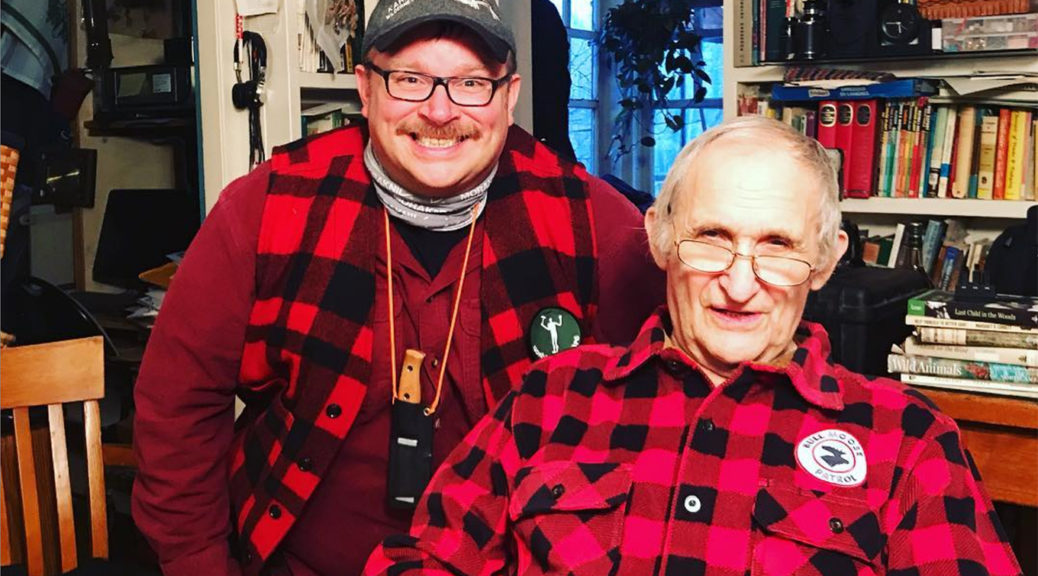 Two Canadian outdoorsmen in red check shirts