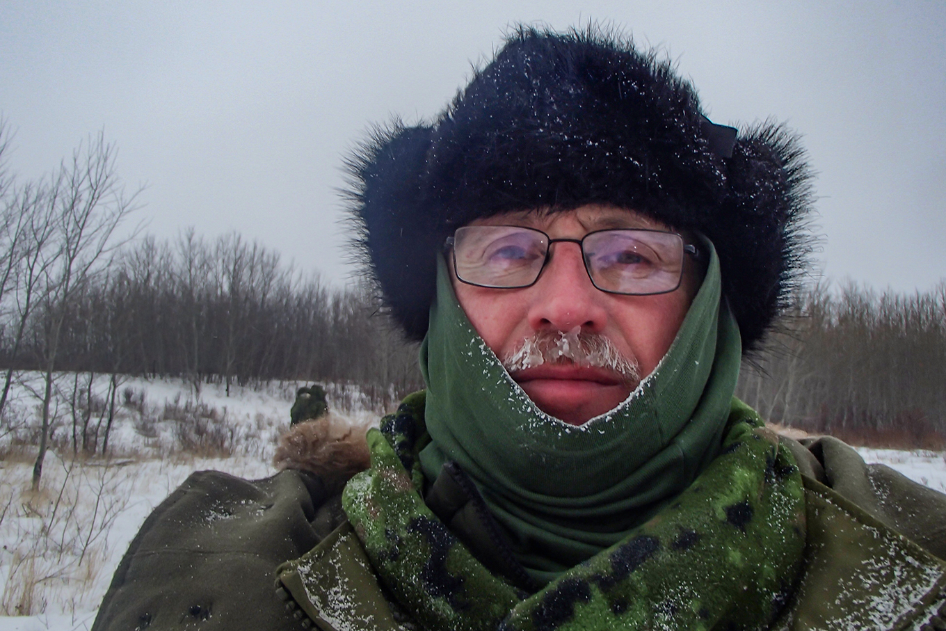 Man wearing frosty winter clothing in Canadian snow conditions.