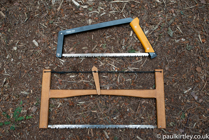 Two folding saws, one metal frame, one wooden frame