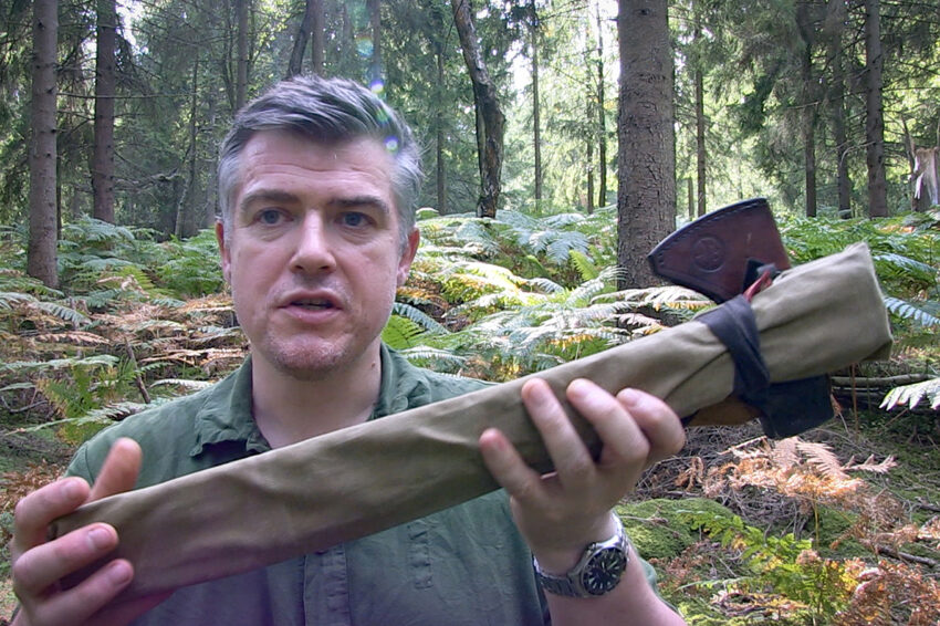 Paul Kirtley holding up axe and saw