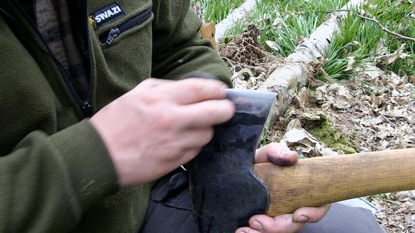 Paul Kirtley sharpening an axe